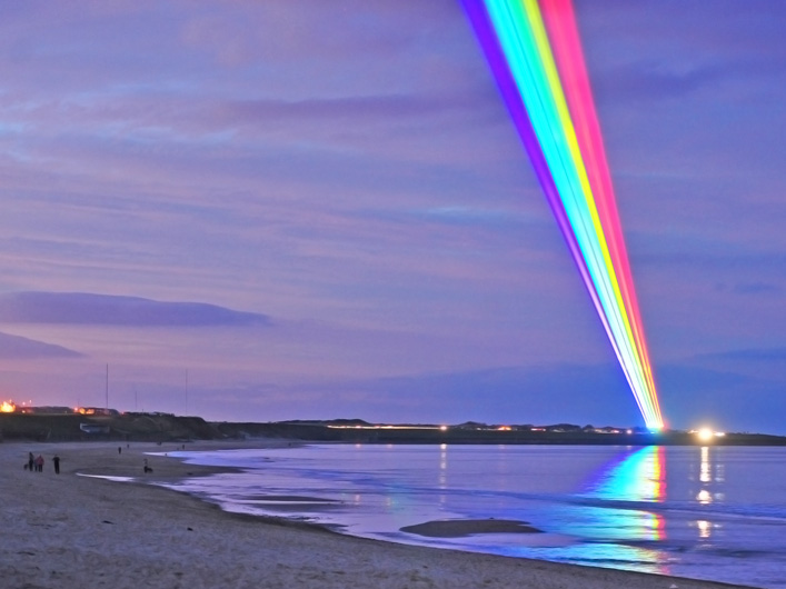 "The skies of North Tyneside in the UK are lit up with vibrant shafts of laser light marking the start of the Cultural Olympiad. Artist Yvette Mattern brings her ""Global Rainbow"" work to the UK, powered by lasers from Lightwave International."